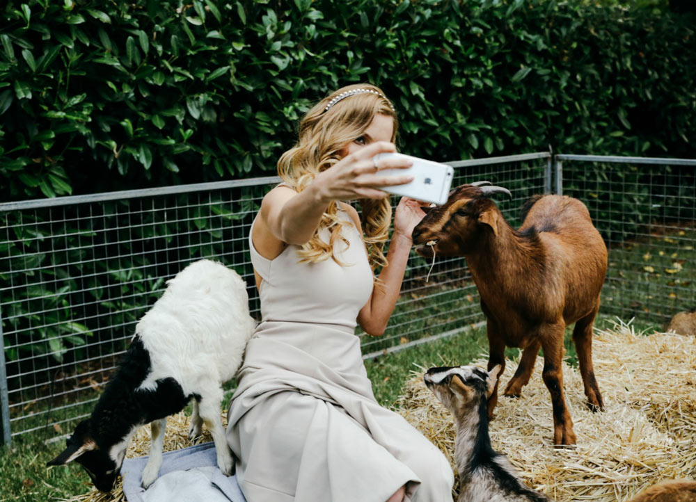 Hopewood-House---Weddings---Emma-&-Lachy---Wiggle-Wedding---Shot-18---Birdesmaid-n-baby-goats.jpg