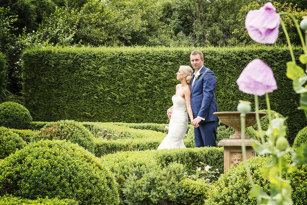 Hopewood House - Images by Sophie - Wedding Day Gallery - Alex and Damo - Couple in the hedge.jpeg