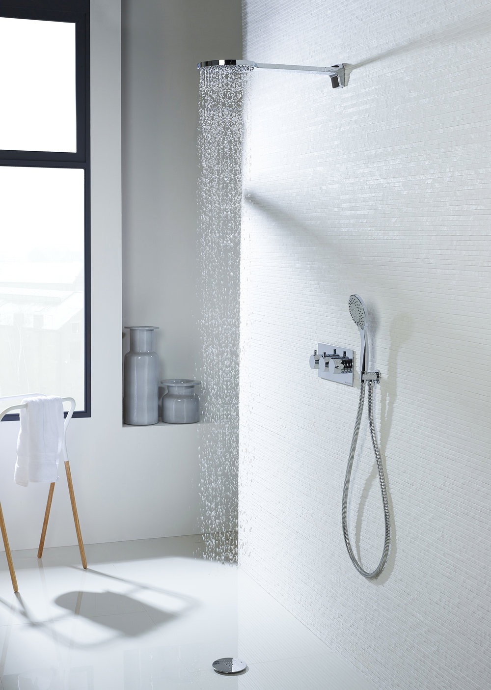Thinking Clearly - Walk in or floor level showers with clear glass panelling and minimal framing are a simple way to open up small space bathrooms.
