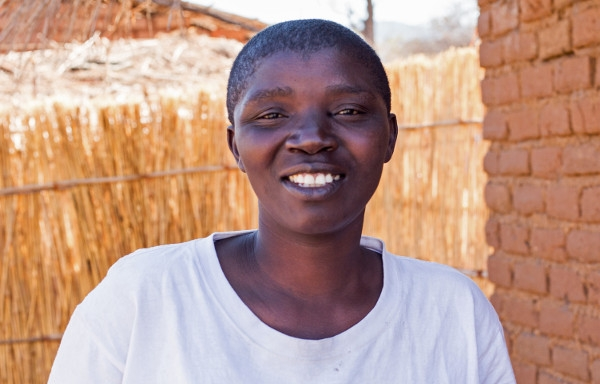 Ruth, a women's group leader, smiling in Malawi
