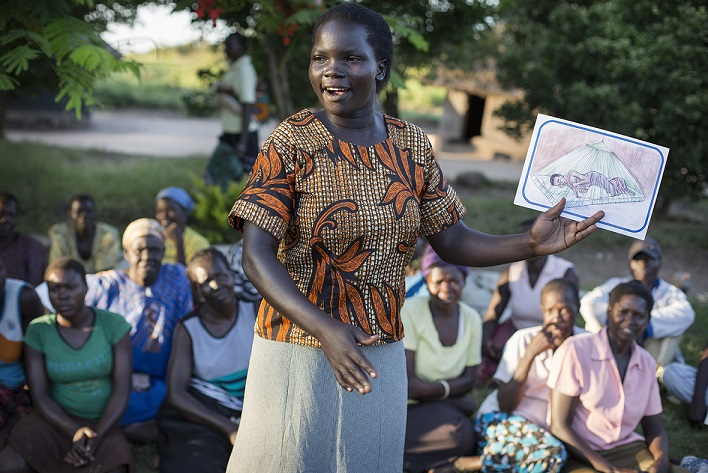 A group leader talks through health problems in pregnancy in Uganda