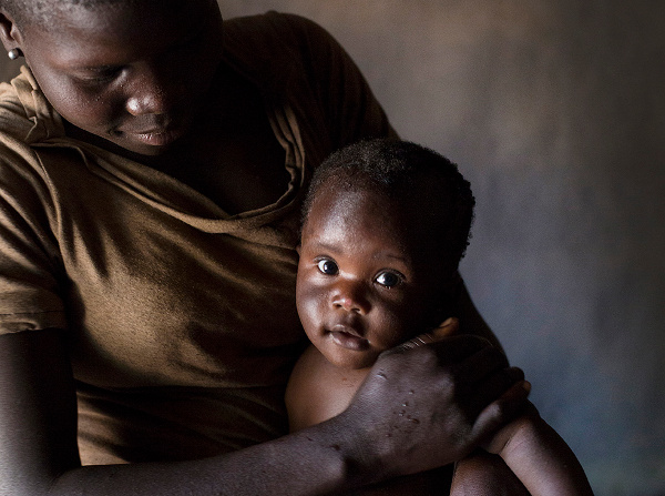 Innocent holding her baby girl, Nancy, in Uganda