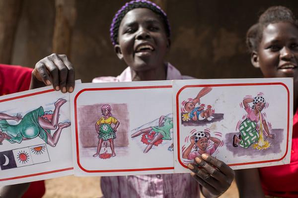 A women's health group meeting in the Kitenge Village, Uganda