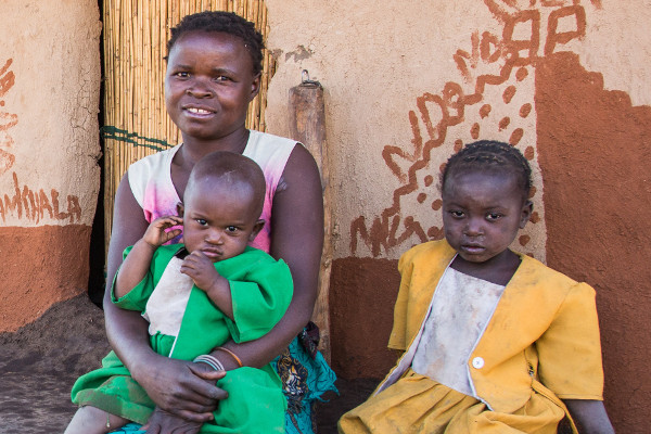 Young family in the Kalonga Village, Malawi (Photo: Corrie Wingate)
