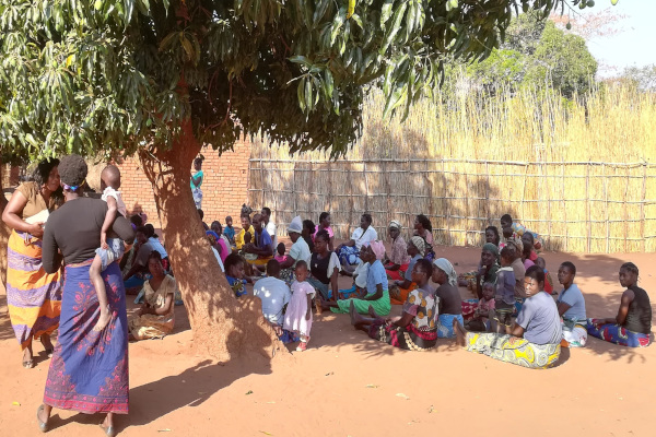 Members of a community group in Salima, Malawi, watching a play about HIV testing being performed