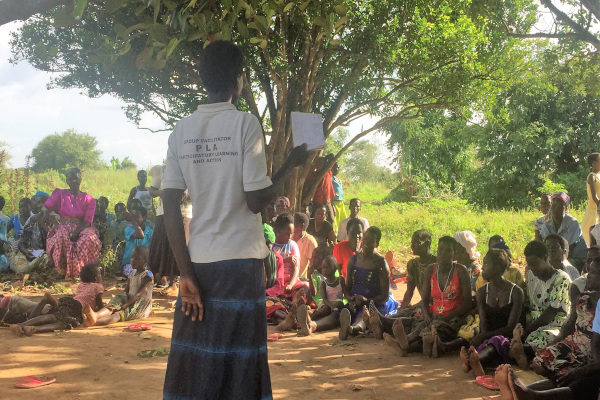 A women's health group meeting, where members are learning about malaria, in Oyam, Uganda.
