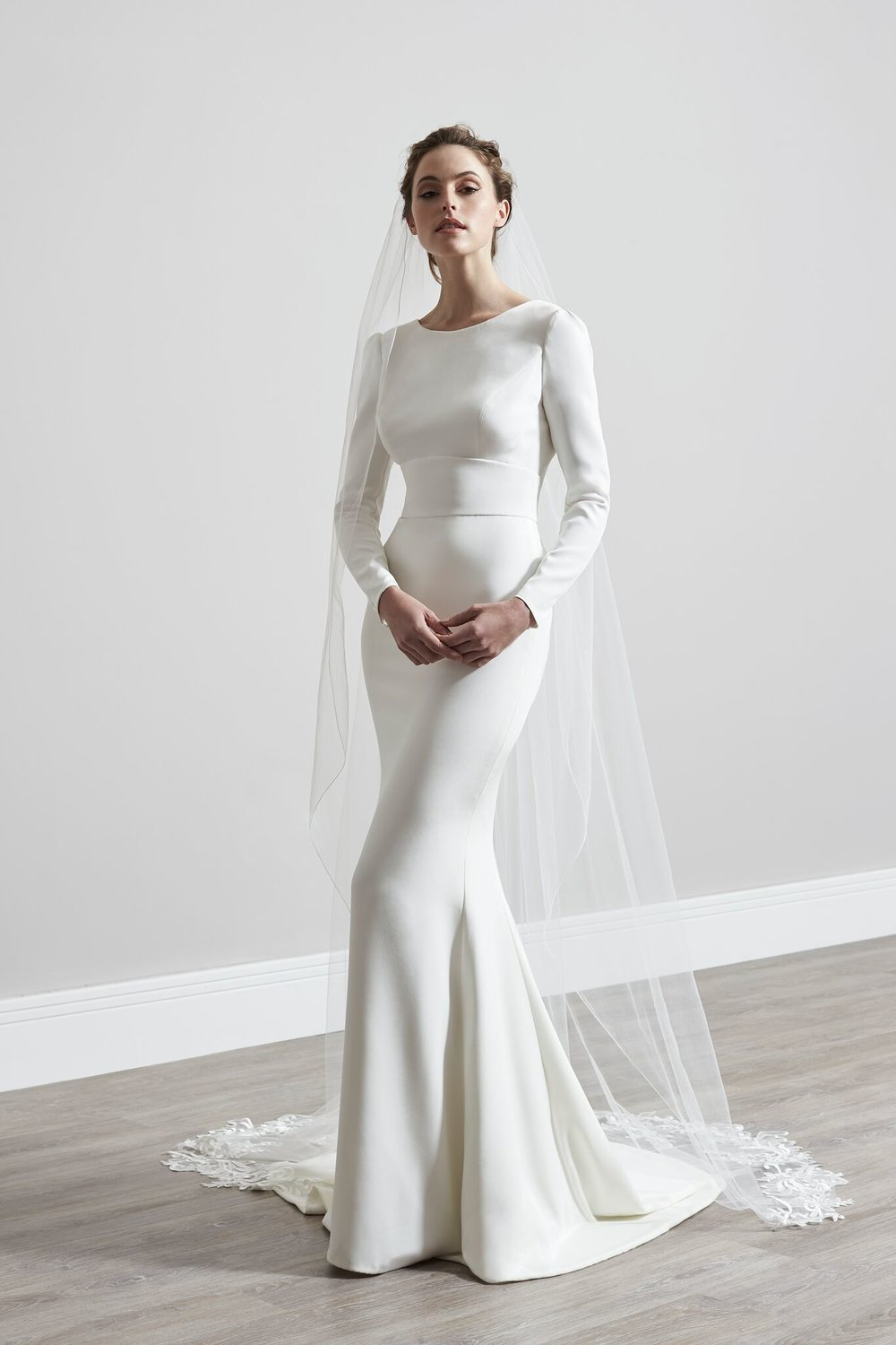 What are some of the key design elements? - Laser cut appliqués, understated embellishments, unique back details and plunging necklines. Silhouettes range from dramatic soft tulle ball gowns or playful tiered skirts to figure hugging fishtails, reflecting the romantic theme of the collection.