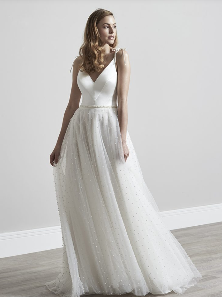 / 8 - SASSI HOLFORD | POLLYPanelled V neck bodice fitted to perfection with a pearl detail tulle skirt. When you walk this dress sounds like summer rain!