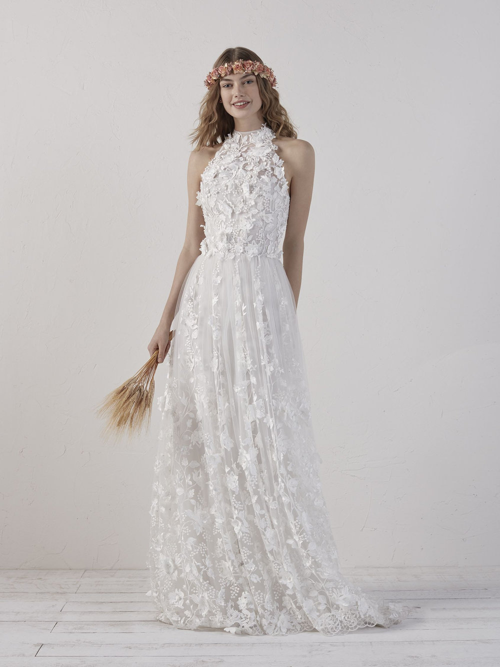 / 13 - PRONOVIAS | EDENA Design crafted in thread-embroidered tulle with speckled pearl appliqués, creating a raised pattern with 3D floral accents that cover the bride's body to give her that bohemian look.