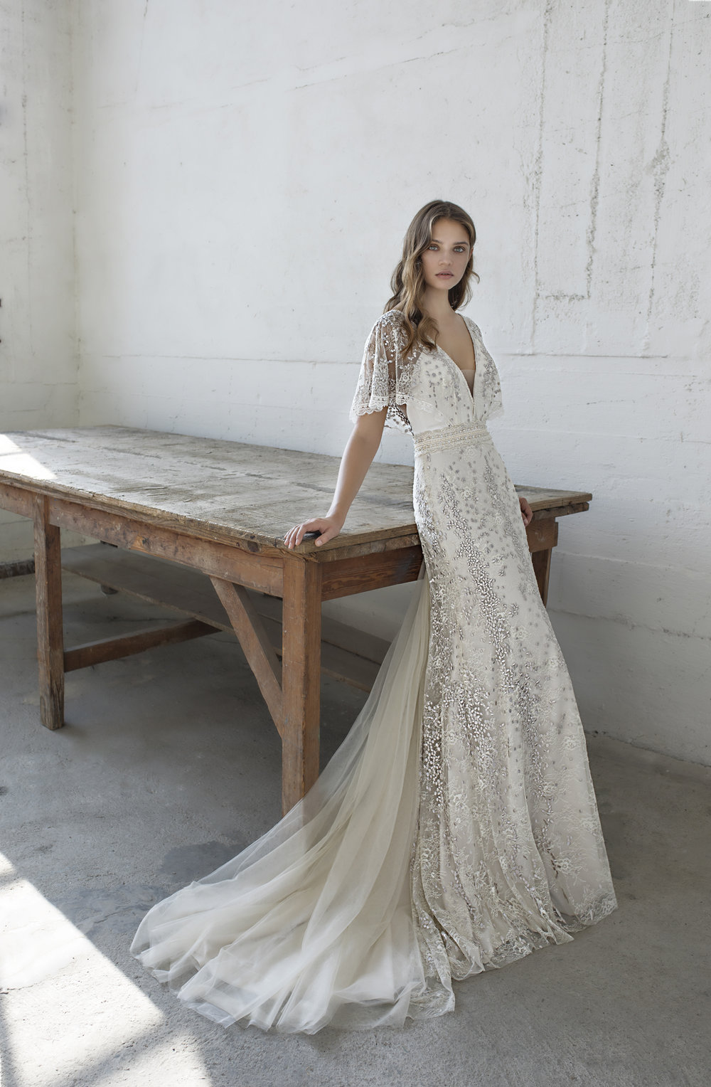/ 9 - MODECA- EDENScattered with gold and burnished embroidery, this free flowing lace dress is the definition of ethereal.