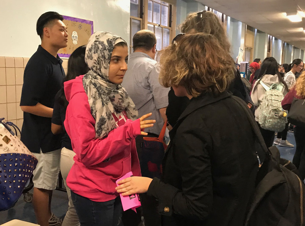 Freshman President Owaish Khan encourages a student to join the government at the Club Fair October 17.  Photo Credit: Rreze Kadrijaj