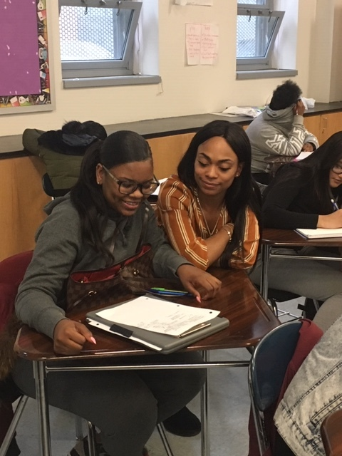 Ms. Morris assists a student in Living Environment.   Photo Credit: Sherry Chen