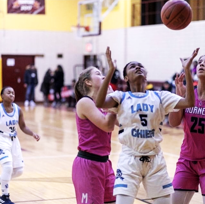 Mary Dolgin '21 fights for a rebound.  Photo Courtesy of Mary Dolgin