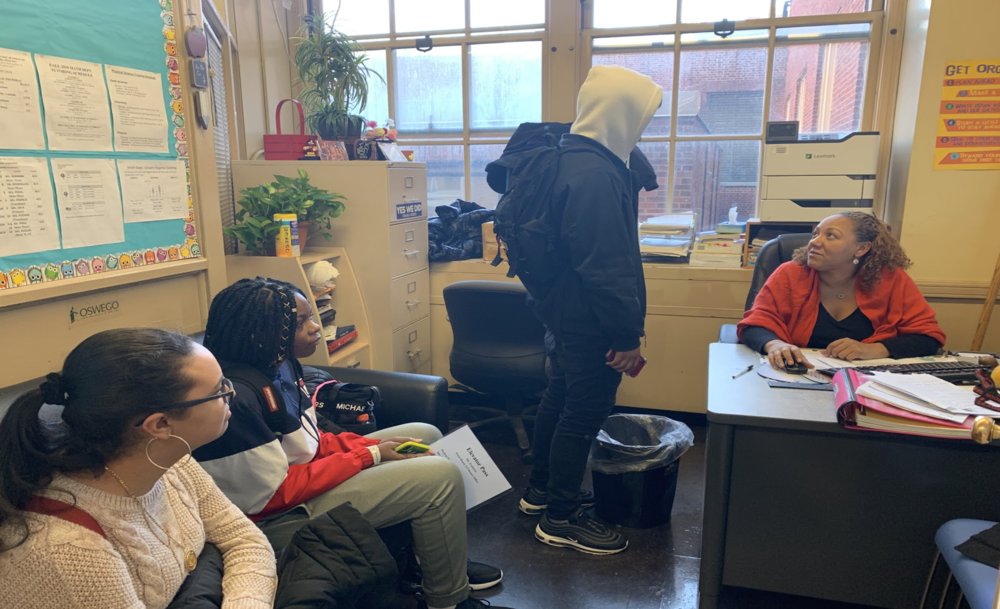 Guidance counselor Ms. Sakaina Simon has a meeting with some of her students.  Photo Credit: Nia Dove