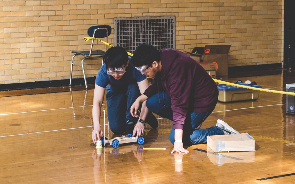 Justin Chow '20 and Josias Gonzalez '20 prepare to launch a mousetrap vehicle.  Photo Courtesy: Justin Chow