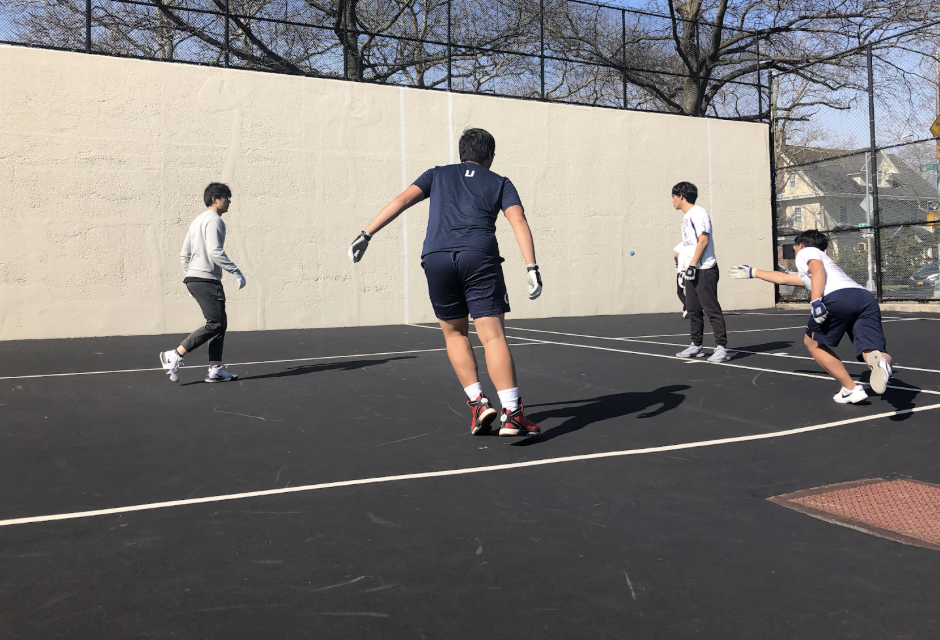 Boys handball practices for their game against Brooklyn Tech.  Photo Credit: Sarah Shoichet