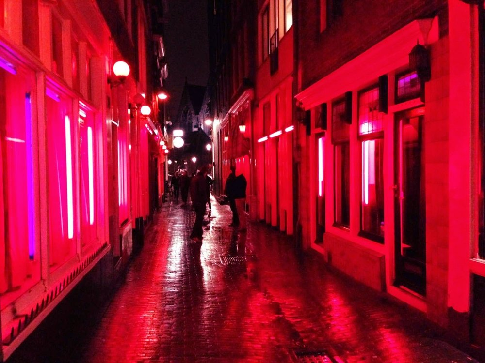 The Red Light District at night with the Old Church in the background