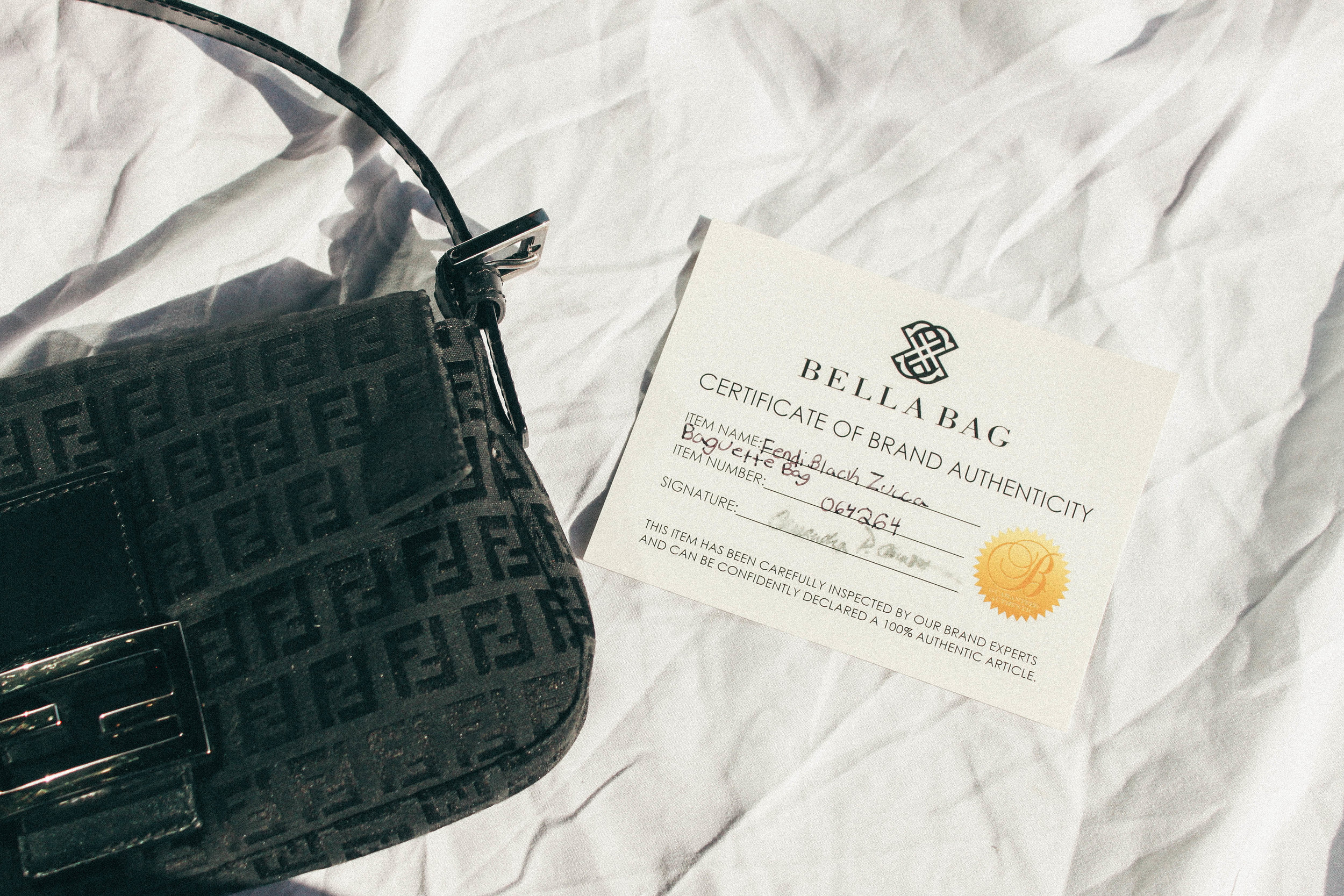 7564bf40bdd6 Fendi Zucca Baguette Bag — Monica s Boutique and Consignment