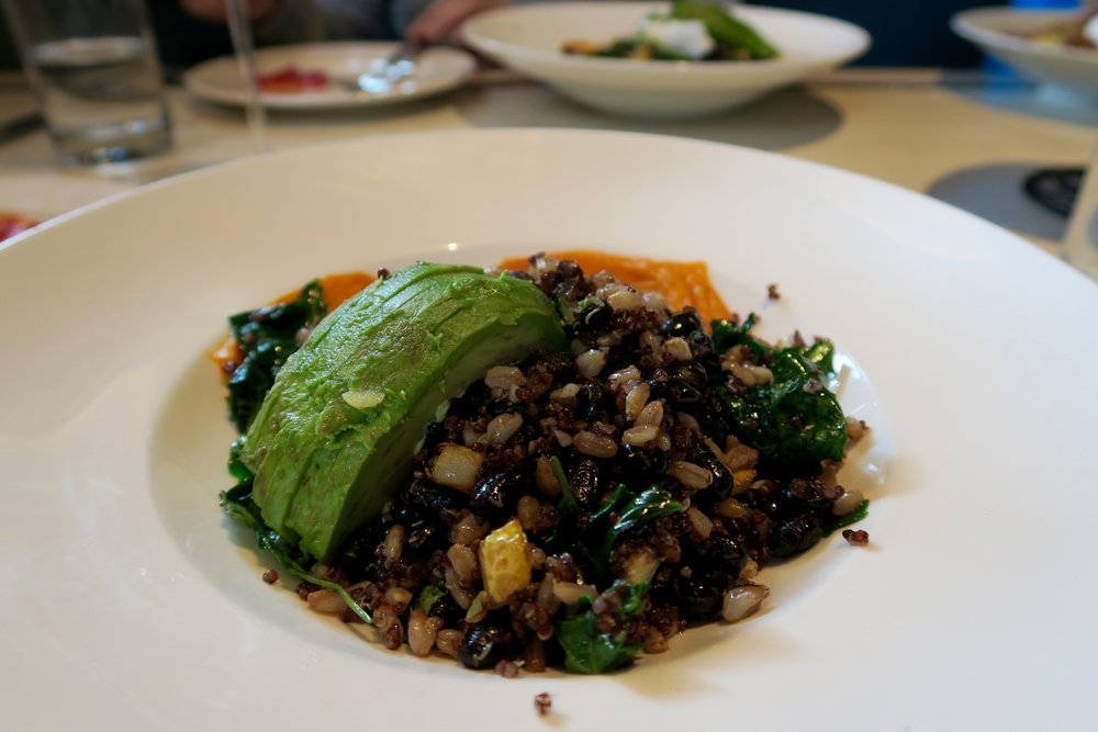 Kale Cashew Grain Bowl  black beans, farro, quinoa, kale, avocado, roasted sweet potato purée, seasonal vegetables