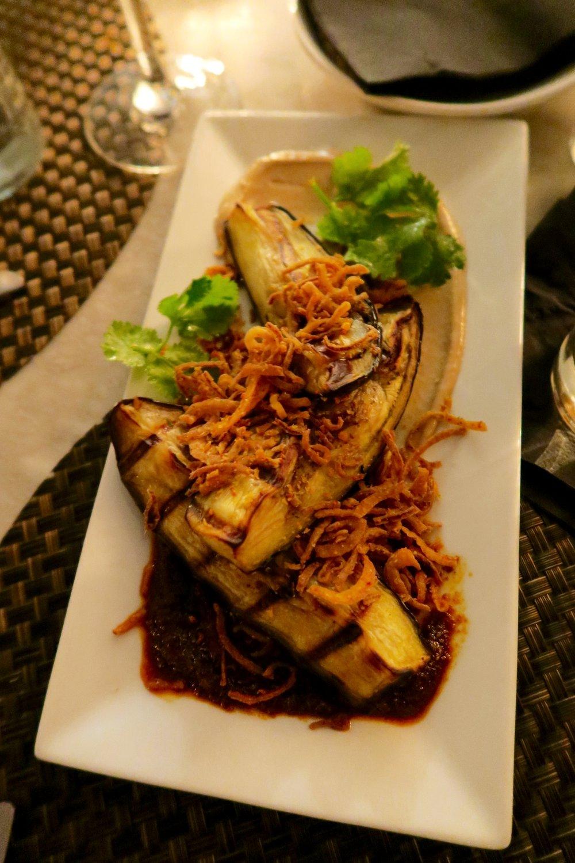 Japanese Eggplant  asian tahini, harissa vinaigrette, crispy shallot, togarashi