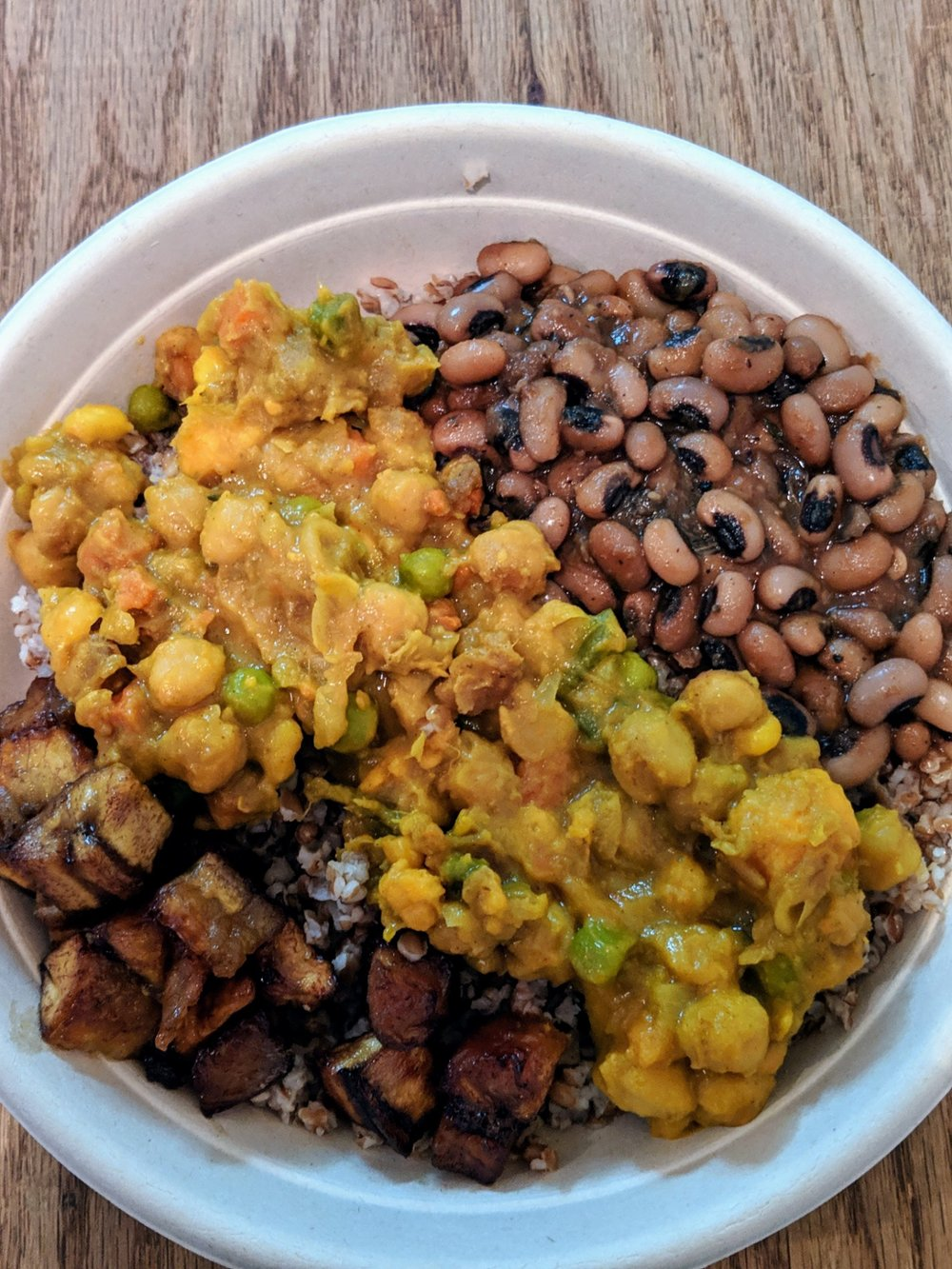 Afro Fusion Bowl  Turmeric fried rice, fried plantains, black eyed pea stew, vegetable curry