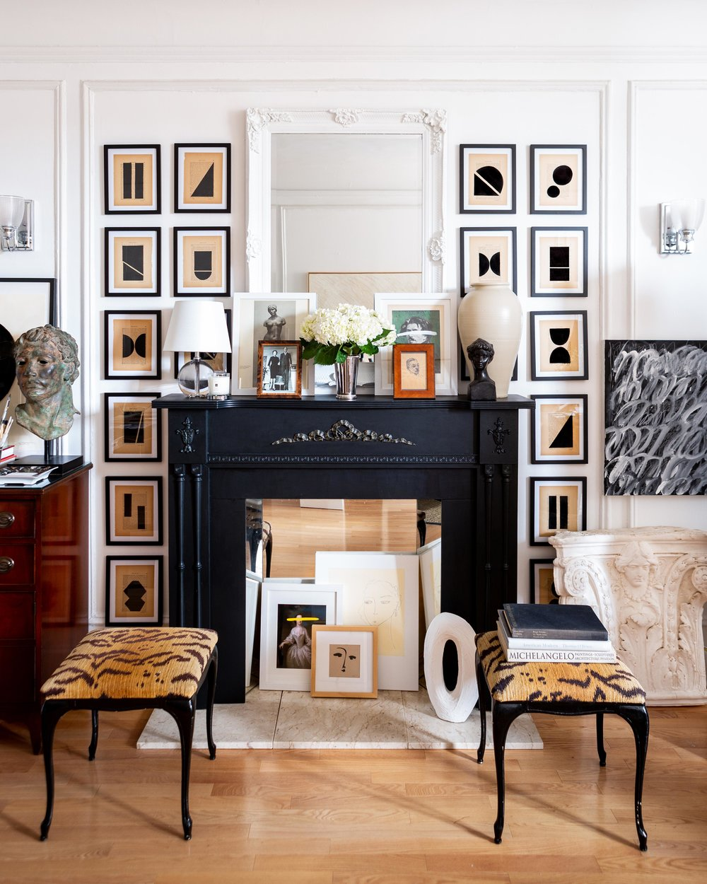 """In all corners of the studio, Young's artwork, such as this full suite of his Géométrique Collection, is juxtaposed with antiques-store treasures and his most beloved art books. """"My work is just as much about the things I love as it is about me,"""" he says."""