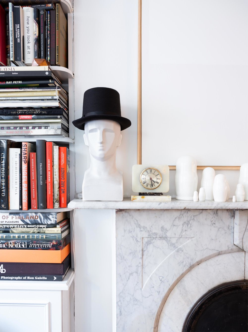 "A grave-looking modernist bust in a top hat? ""It's about taking something deep that's fraught with meaning and emotion, and then offsetting it with something completely silly and funny,"" Teo explains."