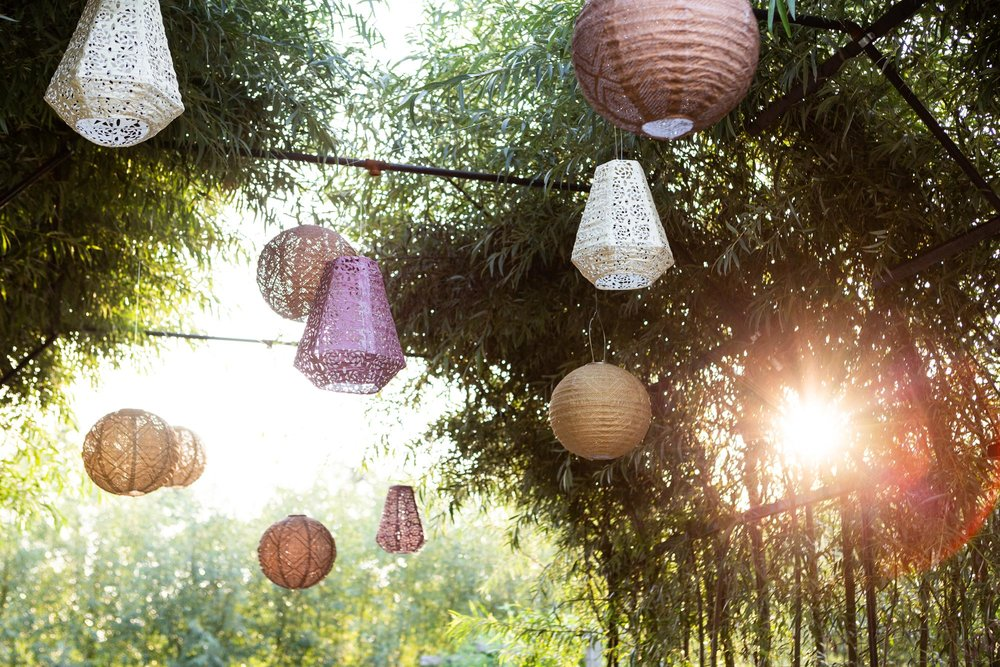 Overhead, lacy, solar-powered Terrain lanterns hang, purposely pell-mell, swaying in the breeze from the trellised archway in the chef's garden.