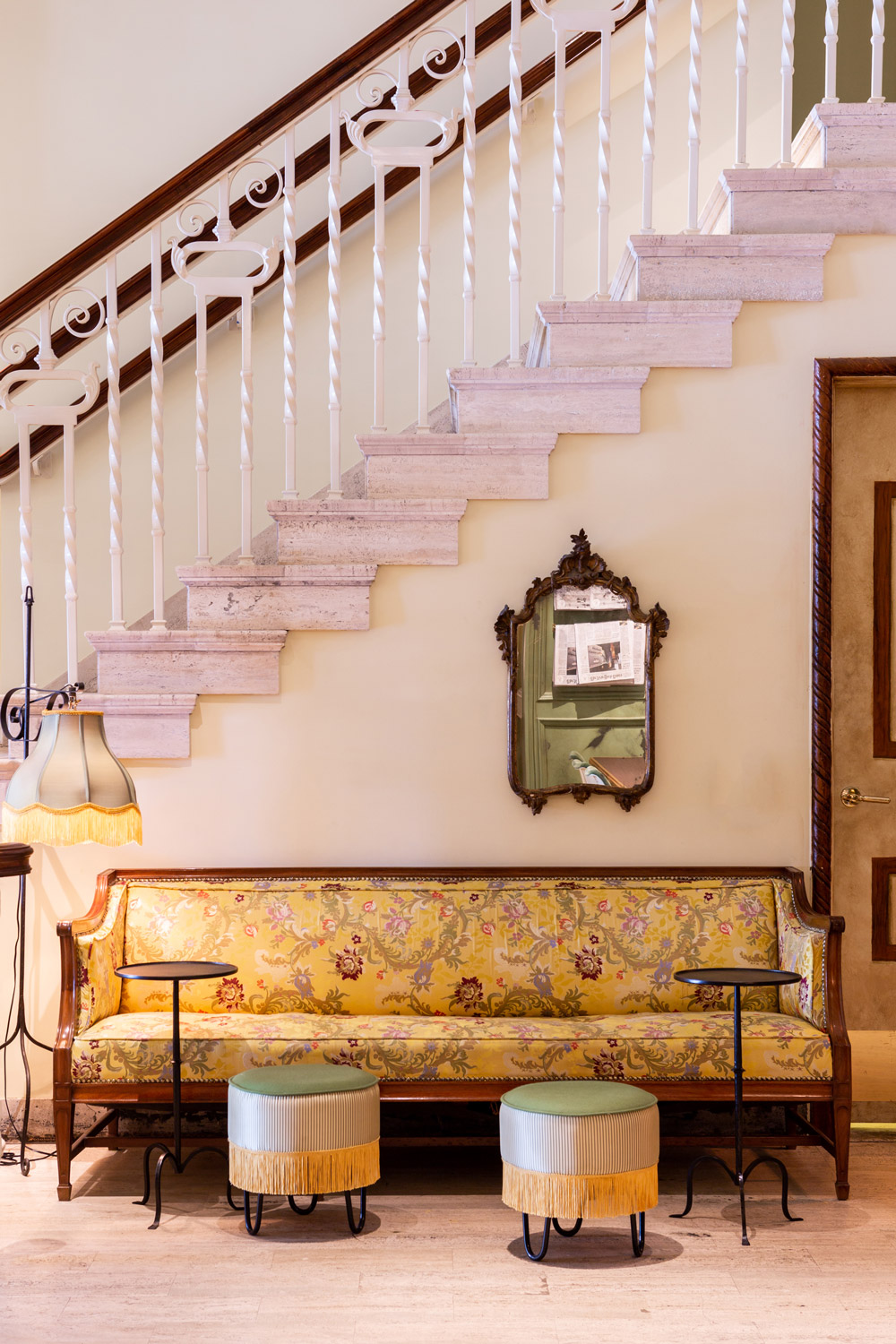 The Siren's lobby is an 11,000-square-foot frenzy of Renaissance Revival architectural detail, custom-upholstered sofas and settees, lavishly adorned 19th-century Italian mirrors, modernist conference tables, and neo-futurist pedestal side chairs.