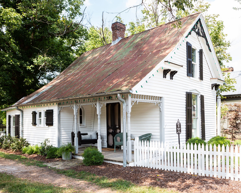 "Holly's tin-roofed Victorian cottage in Leiper's Fork, Tennessee, built in the early 1890s for Carl Sweeney and his family, is only about 1,200 square feet. ""So it's too small to be a home for me, my husband, and three kids,"" she says. ""But it's a dreamy weekend escape."""