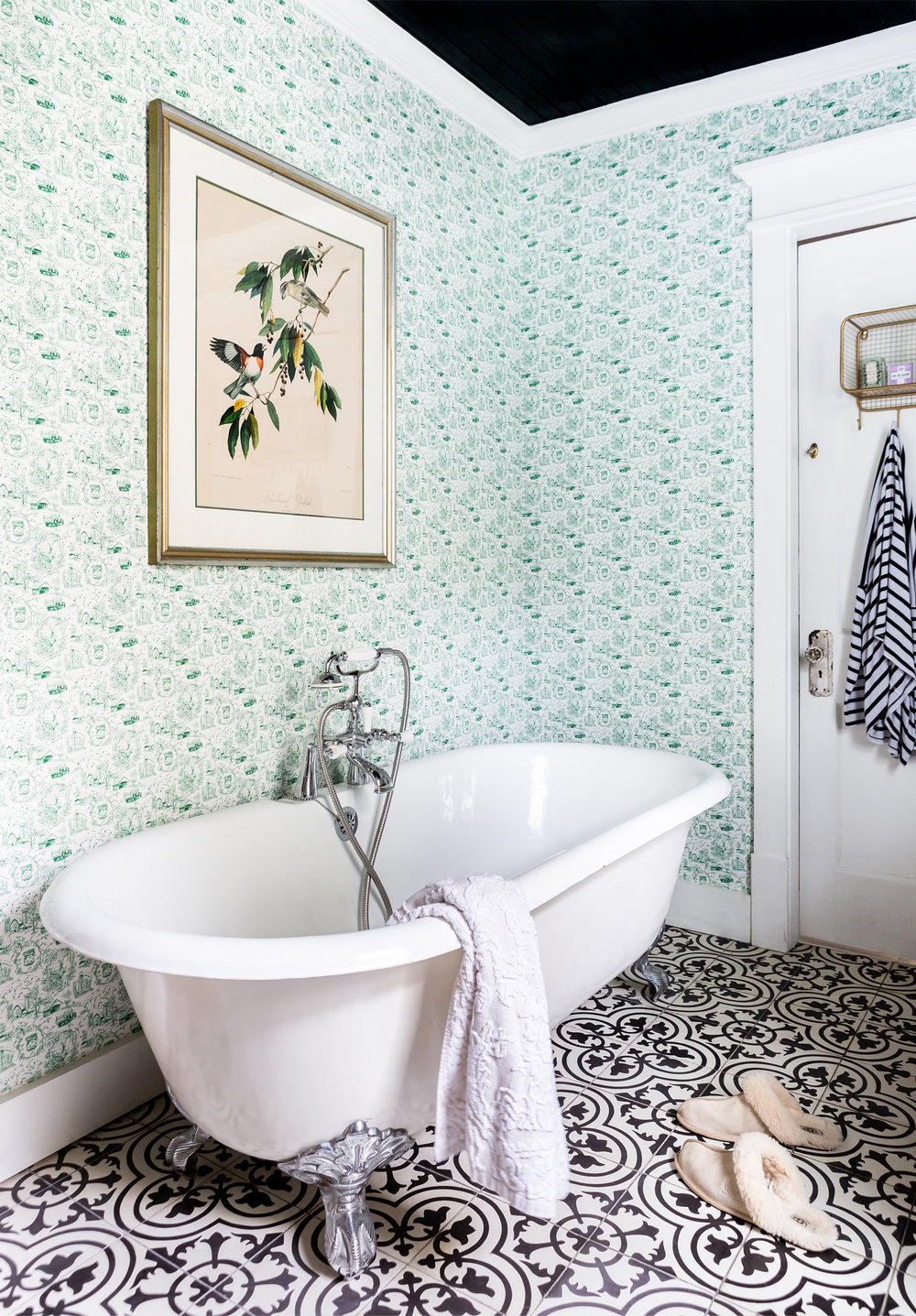 Like her kitchens, Holly's bathrooms are lovely (though wholly utilitarian) spaces. At Fox Country Farmhouse, she's used a Kohler trough sink and faucets; Tabarka Studio floor tiles; custom Country Living wallpaper; a spacious subway-tiled shower; and her always-mandatory antique soaking tub.