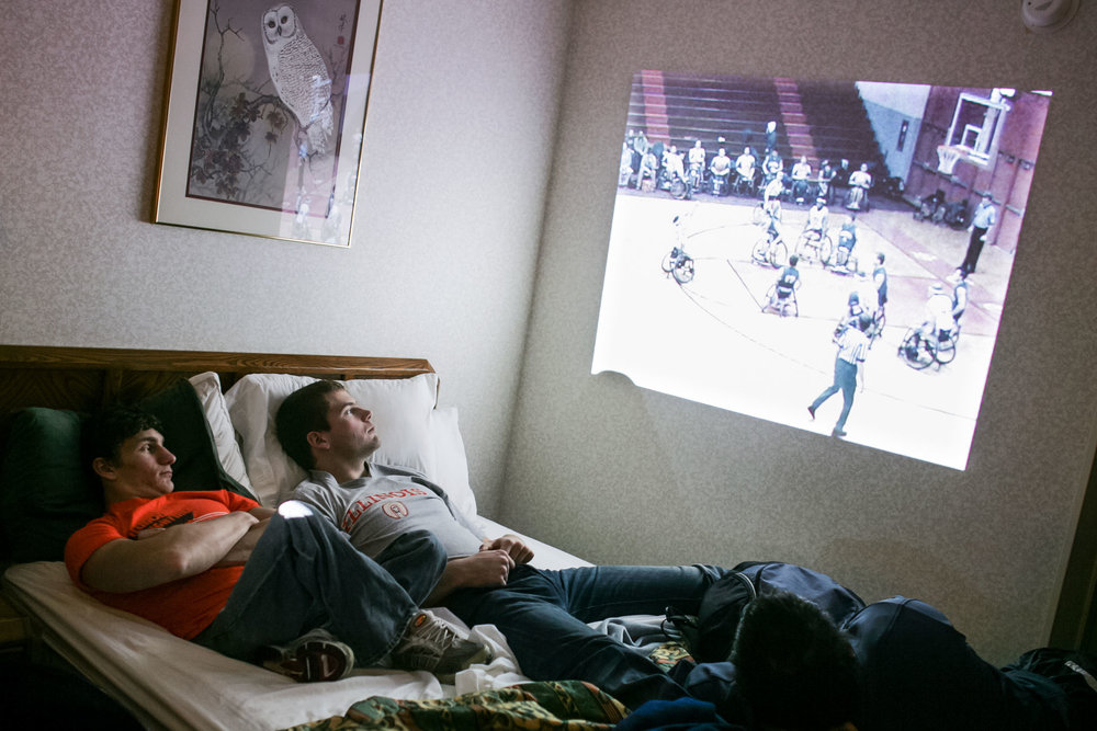 Josh George, left, and Lars Spenger watch video of a previous game against Edinboro University in head coach Mike Frogley's hotel room. They regularly study past games to learn from mistakes and improve.