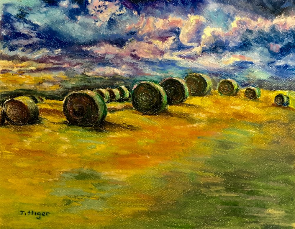 SYMMETRY   This is a pastel of round bales. I altered the photo I took and added vibrant color.