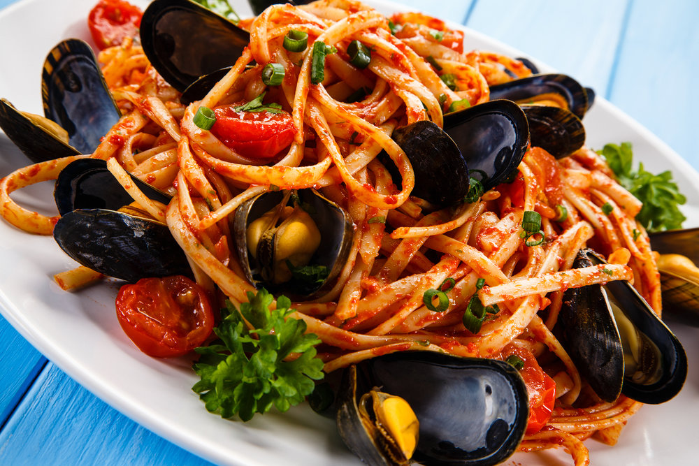 bigstock-Cooked-mussels-and-pasta-118533878 (1).jpg