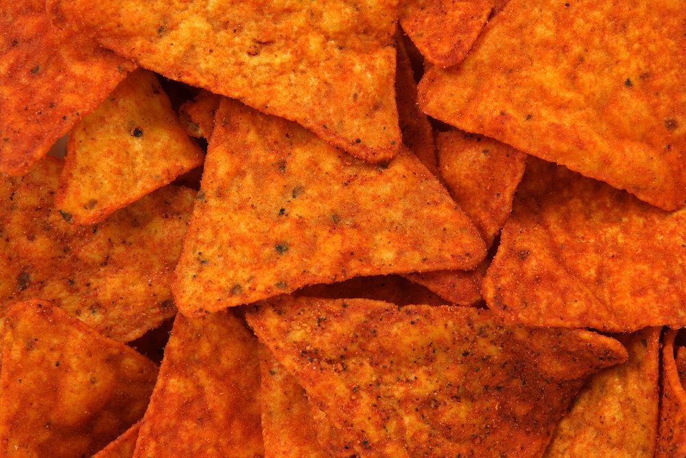 bigstock-Hot-Corn-Chips-Background-3012040.jpg