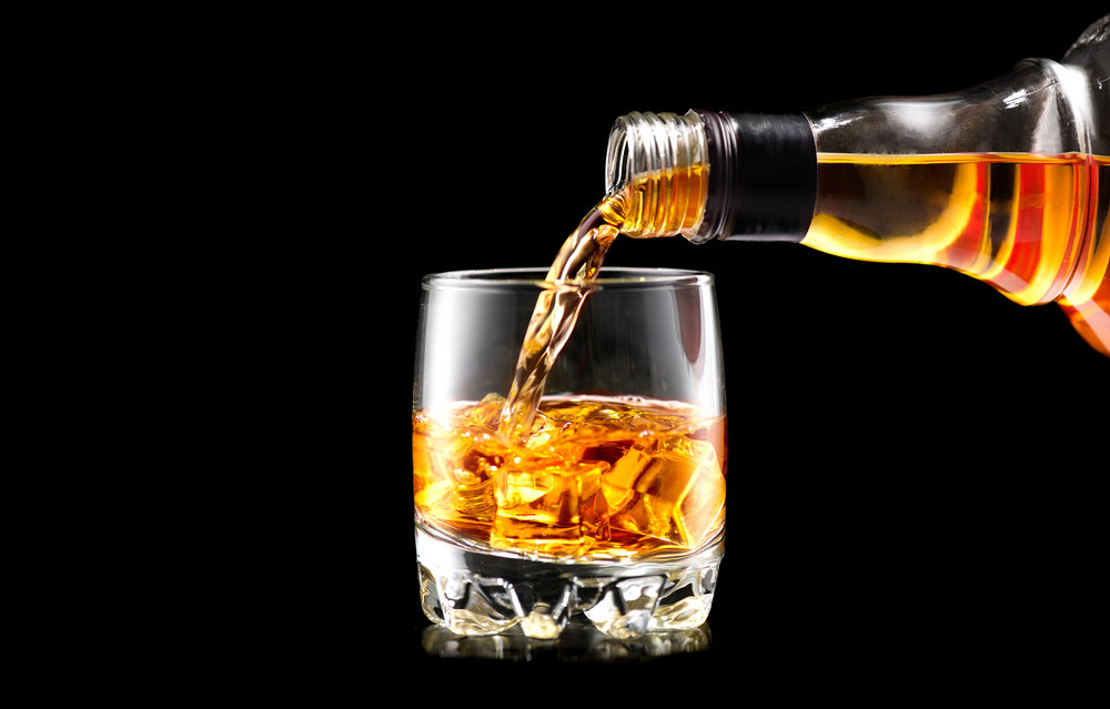 bigstock-Whiskey-with-ice-Pouring-whis-213581107.jpg