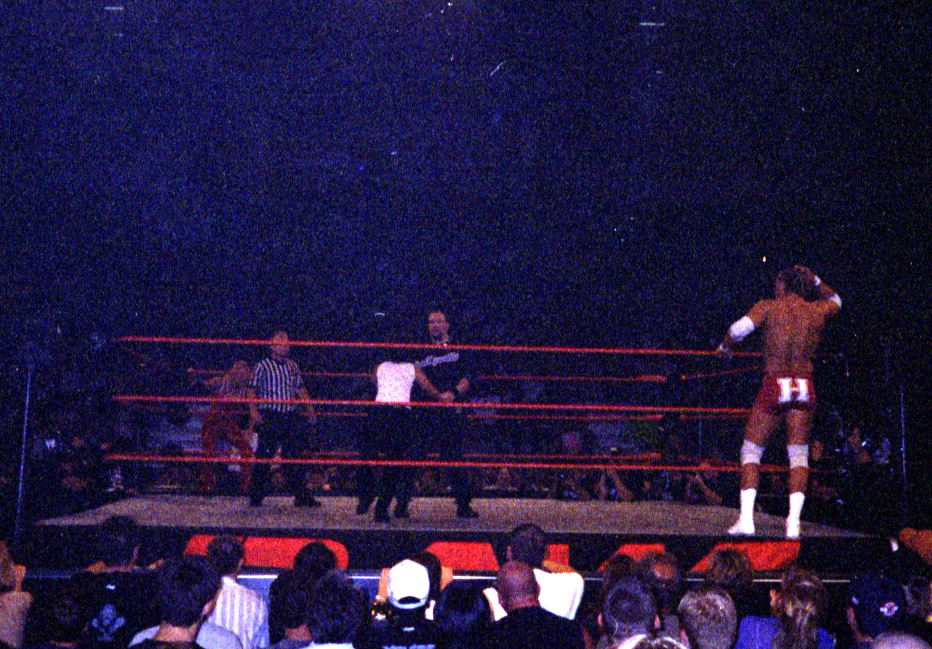 Chris Nowinski, right, stands on the ring apron during a mixed tag team match on Monday Night Raw at the Bradley Center in Milwaukee on Sept. 2, 2002. Nowinski teamed with Molly Holly against Bubba Ray Dudley and Trish Stratus. (Photo by Mike Pankow)
