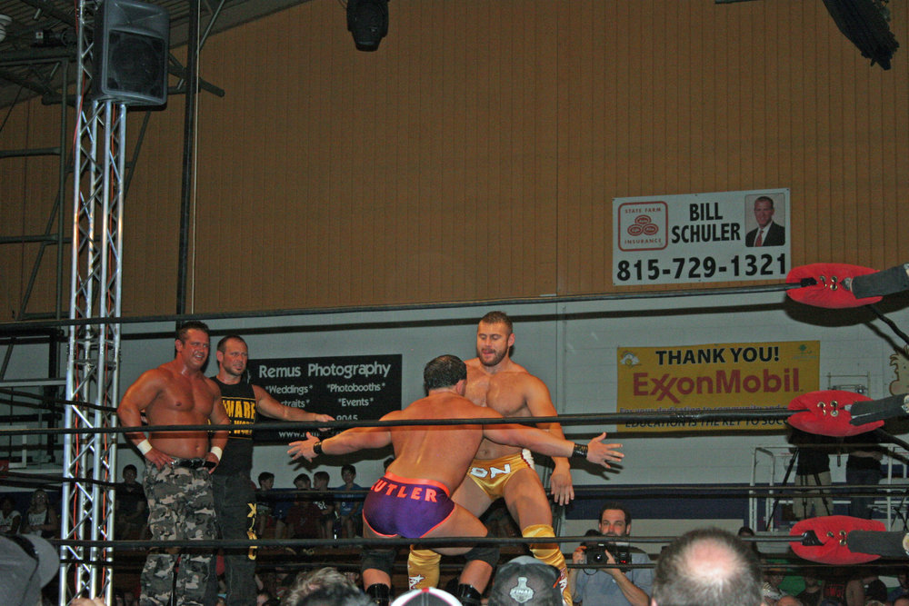 Brian Christopher (aka Grandmaster Sexay), left, and Scotty 2 Hotty watch Nick Cutler and Brian Nelson dance before their tag team match at Pro Wrestling Blitz's WrestleFest 5 in Joliet, Ill. on Aug. 9, 2014. (Photo by Mike Pankow)