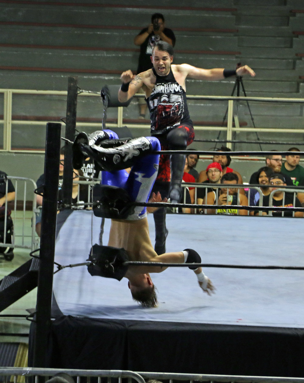 With Mark Andrews in the tree of woe, Jimmy Havoc delivers a kick in the corner.
