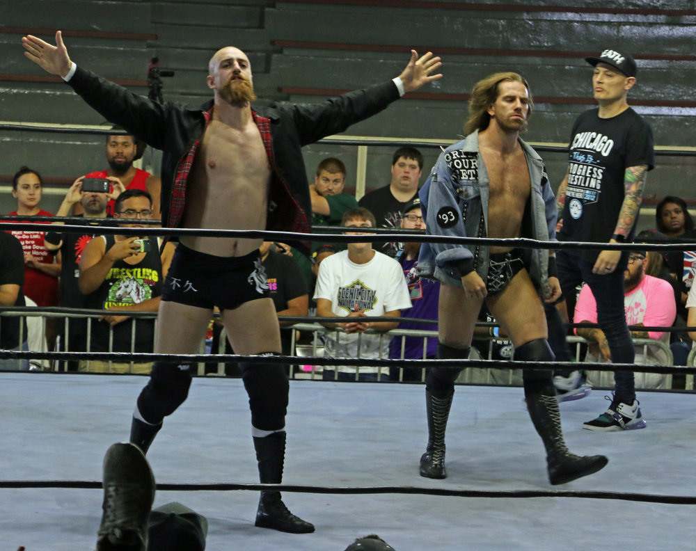 The Grizzled Young Veterans, Zack Gibson, left, and James Drake, enter the ring.