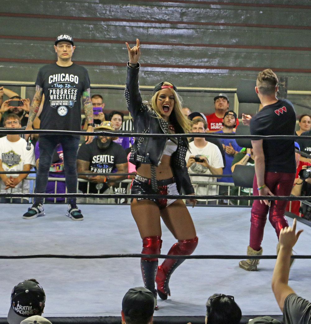 The popular Toni Storm poses for the crowd before teaming up with Jack Sexsmith and Darby Allin.