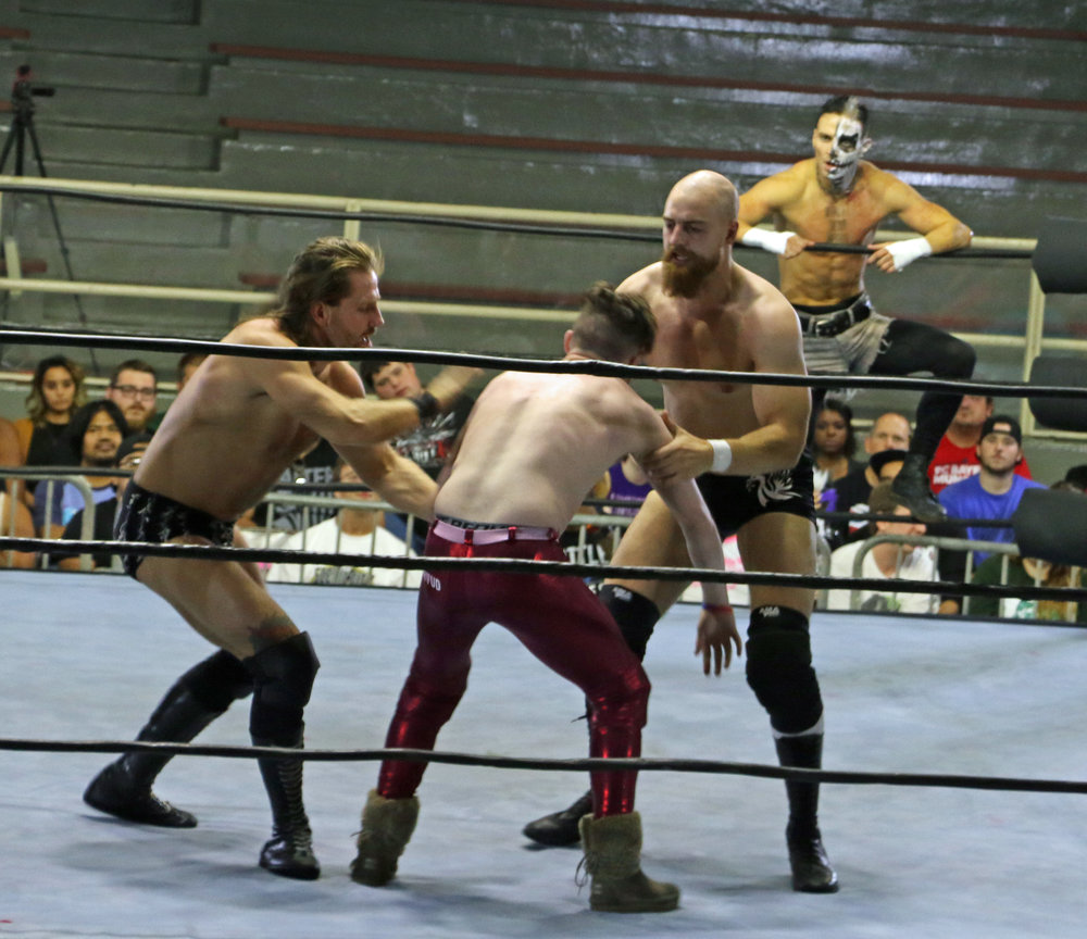 James Drake, left, and Zack Gibson double team Jack Sexsmith.