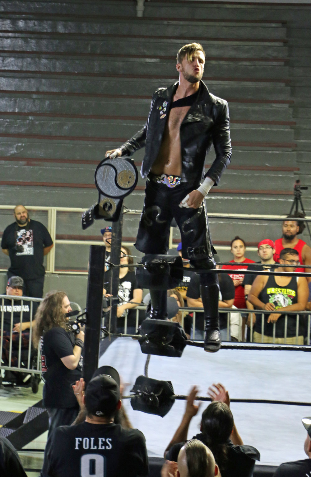 Chris Brookes, co-holder of the PROGRESS Tag Team Championship, poses for the fans before the match.