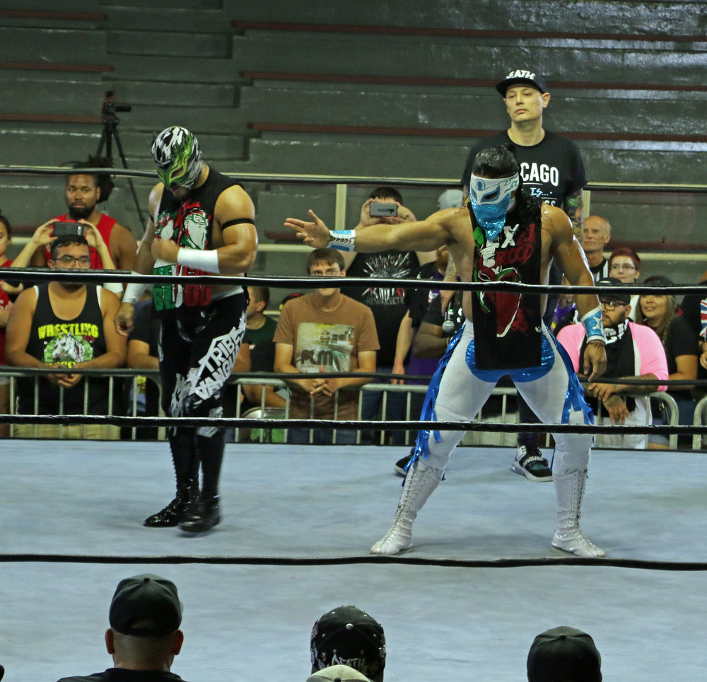 Flamita, left, and Bandido pose before the tag team match.