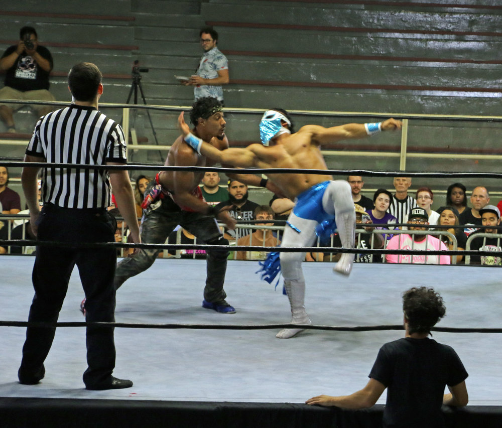 Bandido, right, taking down AR Fox at PROGRESS Wrestling's Chicago show on August 11, will team up with Rey Mysterio and Fenix to face The Young Bucks and Kota Ibushi in a six-man tag team match at All In.  (Photo by Mike Pankow)