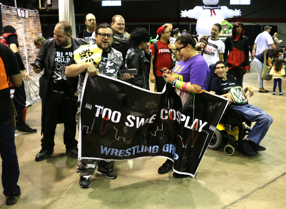 "Steve ""Stvo"" Jay (as Bubba Ray Dudley) holds the Too Sweet Cosplay banner before the march toward the lobby for the group's photoshoot."