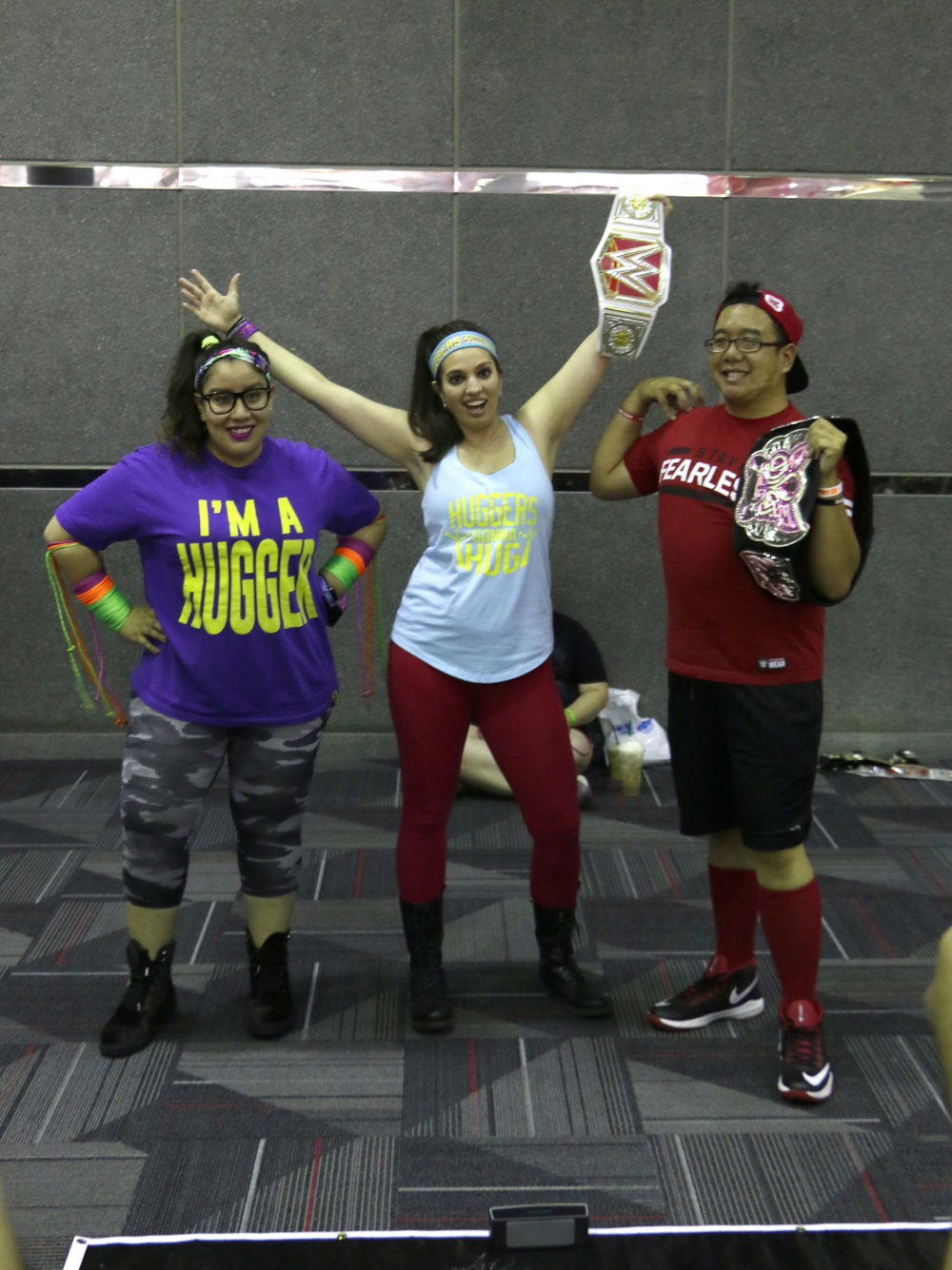 Two Bayleys and a Nikki Bella cosplayer.