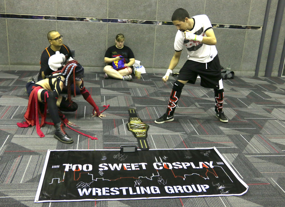 The Balor Club squares off against CM Punk in the lobby.