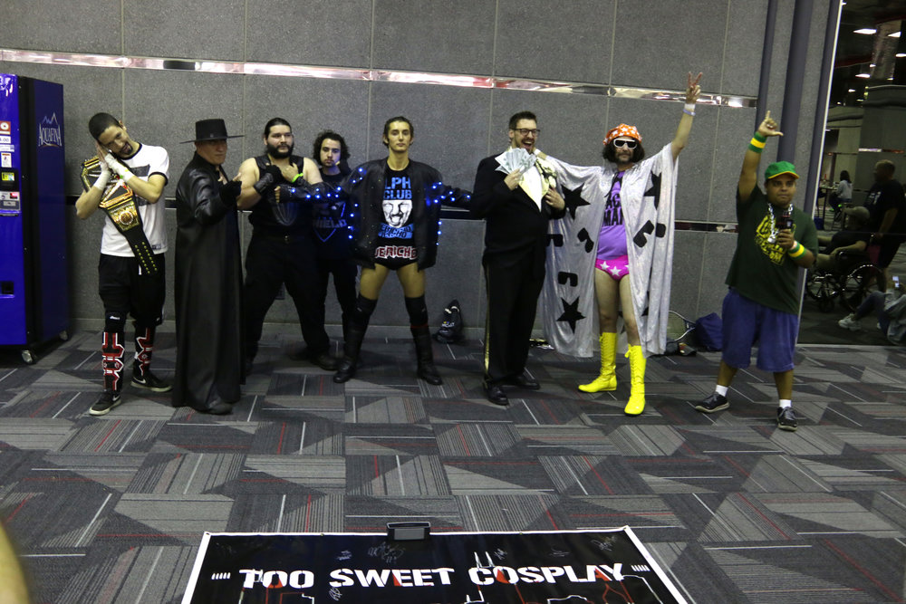 Too Sweet Cosplay representing wrestlers from WrestleMania main events.