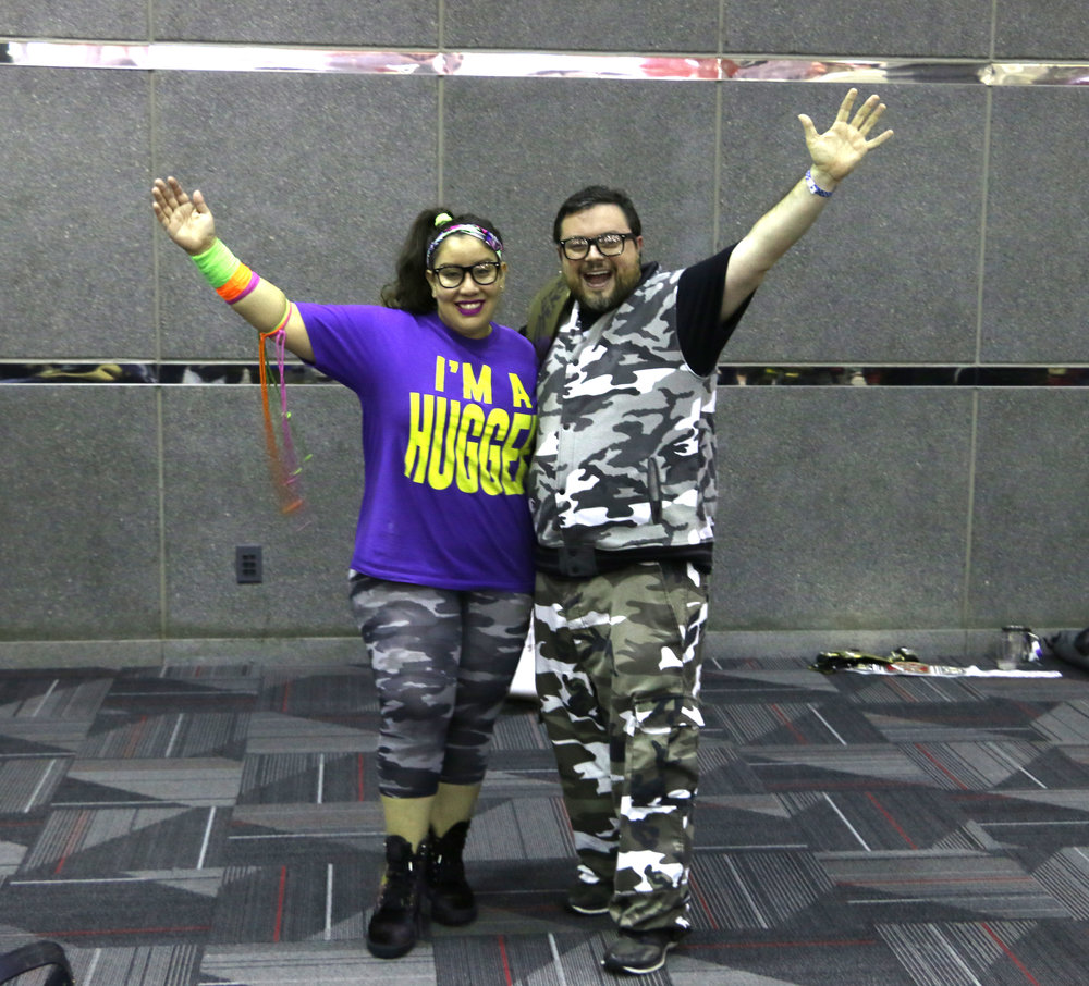 Raquel Cee (as Bayley), left, and Steve Jay (Bubba Ray Dudley) pose in the lobby.